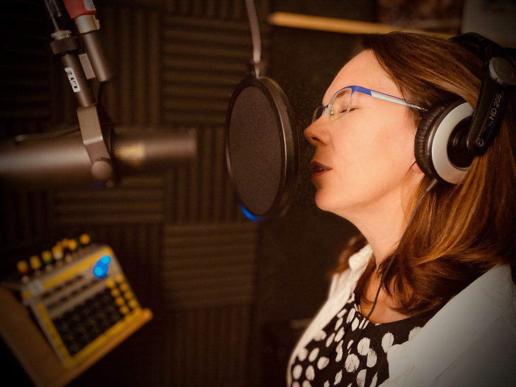 Claire singing at 3507 Studio Recording