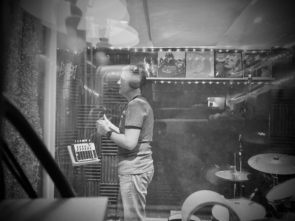 Andrew Tuton vocal recording in the booth